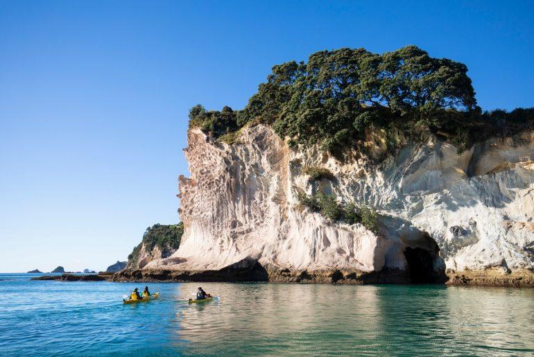 Kayakers on Cathedral Cove at Coromandel Peninsula