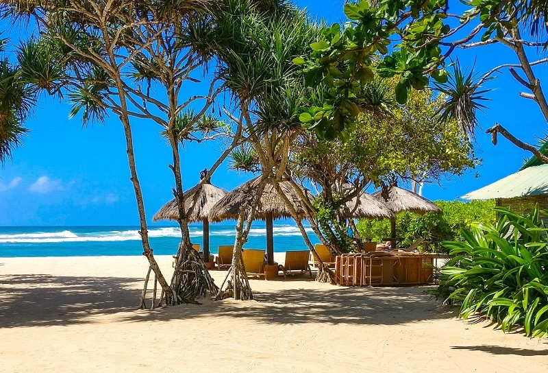 Beach umbrellas and sunloungers in Nusa Dua, Bali