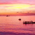 A sunset over a Bali beach